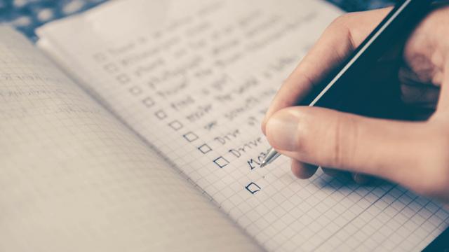 blog header: person writing a checklist