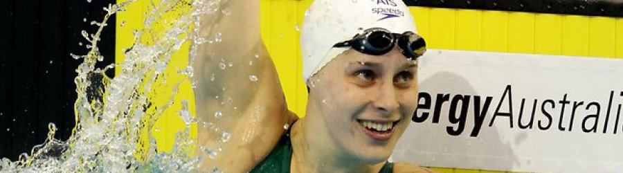 Image of Belinda Hocking smiling as she celebrates her victory in a swimming championship