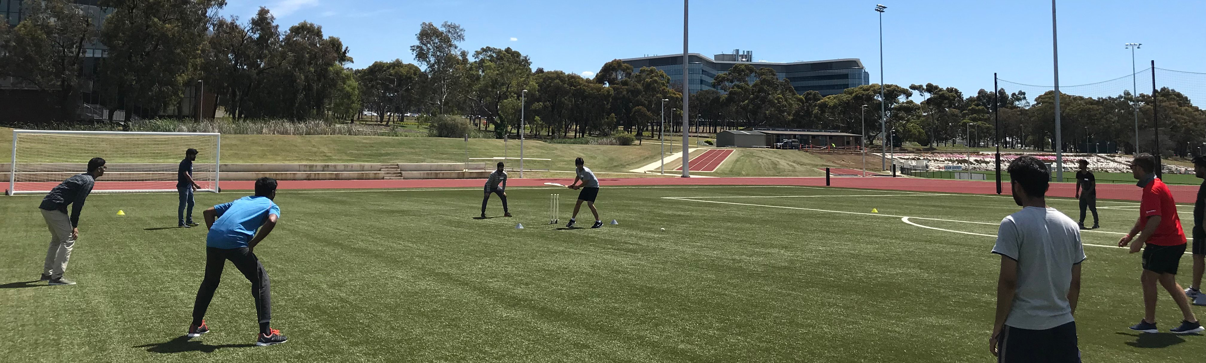 Students playing cricket at Deakin