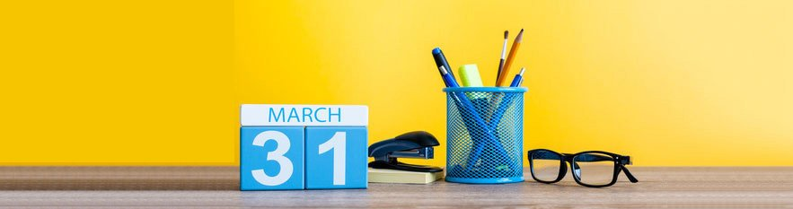 A desk calendar with the date 31 March