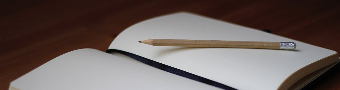A pencil and notebook