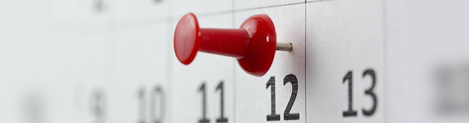 A pin on a calendar
