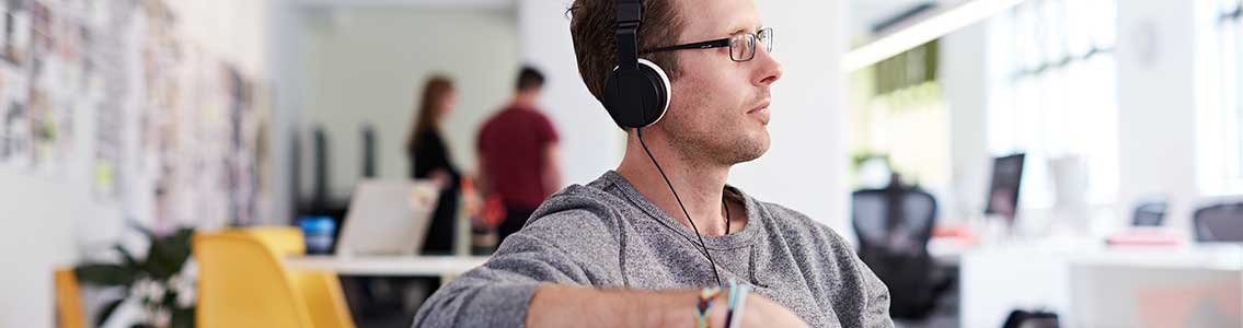 A Cloud Campus student studying with headphones