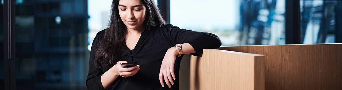 A Cloud Campus student communicating on her mobile phone