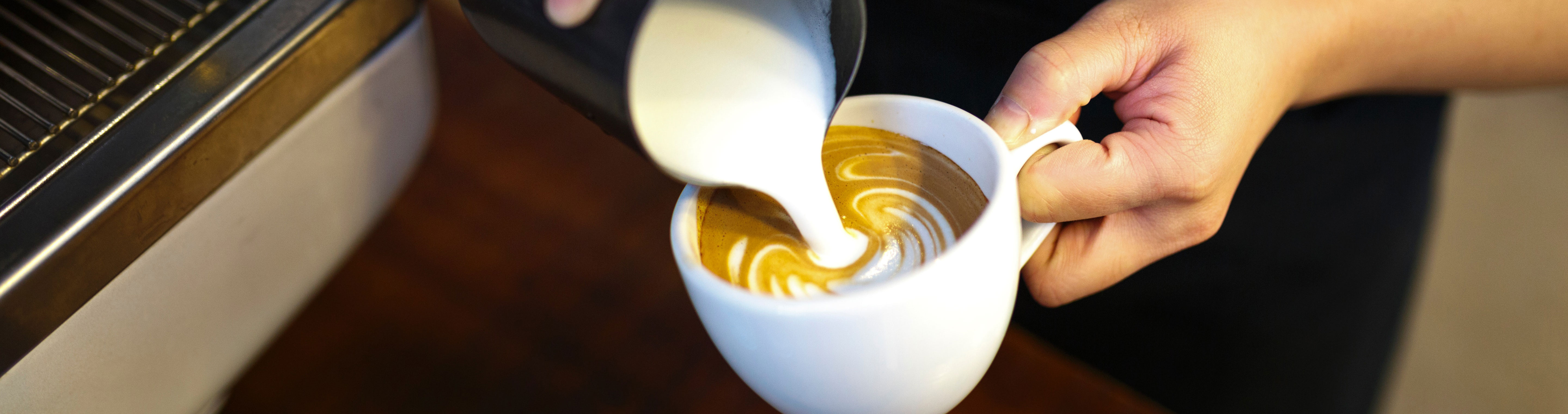 Person pouring coffee