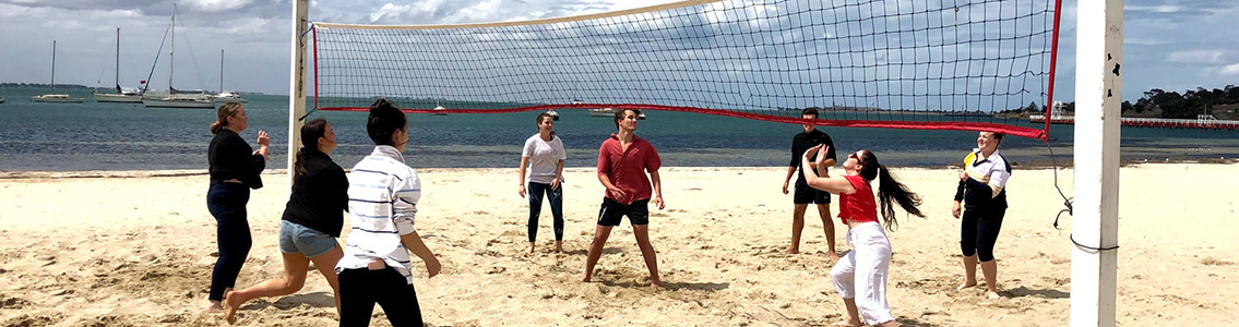 Residential students playing beach volleyball