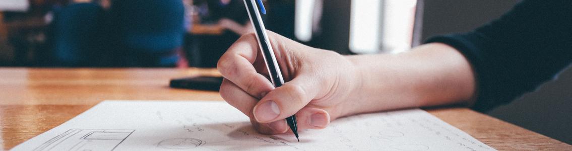closeup of person writing