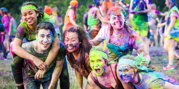 Students pose for a photo amid the colour powder fight at the 2019 DUSA OCamp