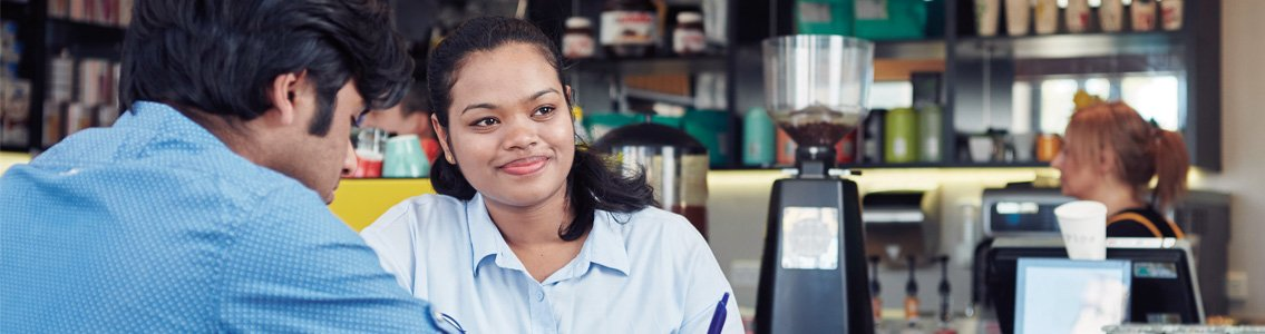 Smiling woman sitting in cafe with friend
