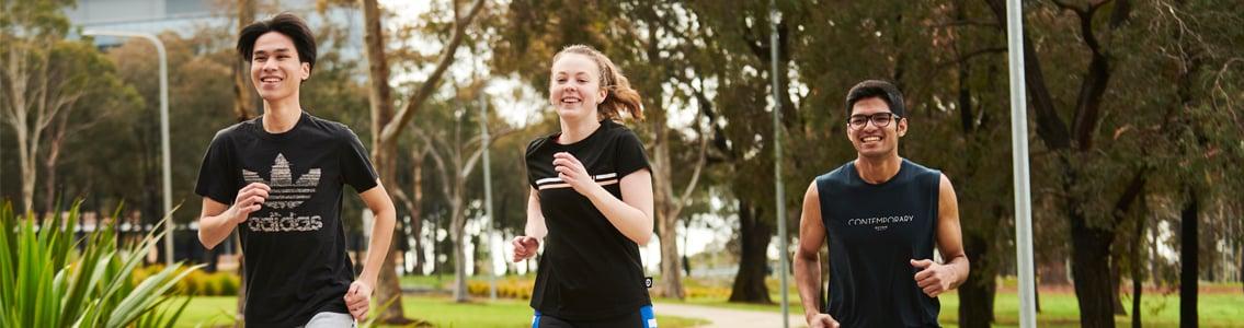 Three students jogging at Waurn Ponds Campus