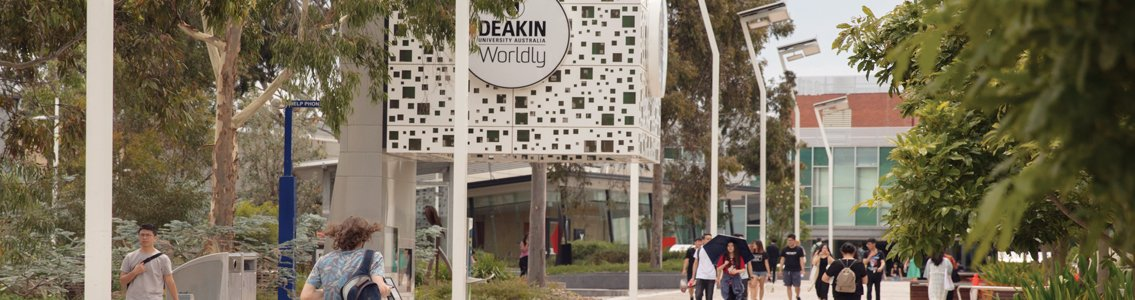 Students walk along Morgan's Walk at the Deakin Burwood Campus