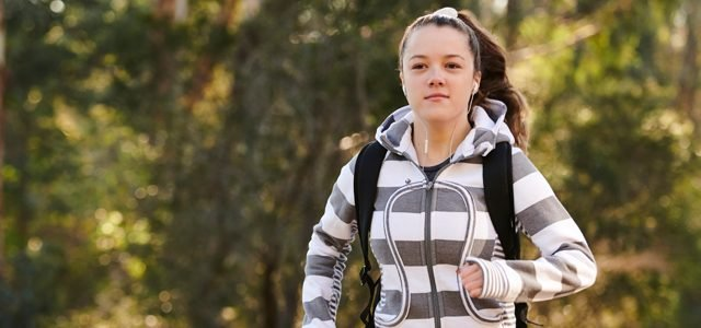 Student jogging through bushland