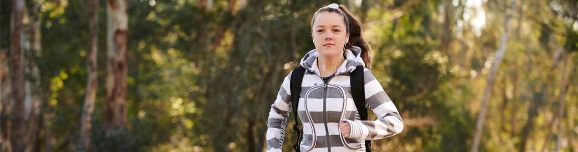 Student jogging through bushland
