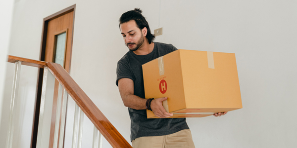 Man carrying box while moving house