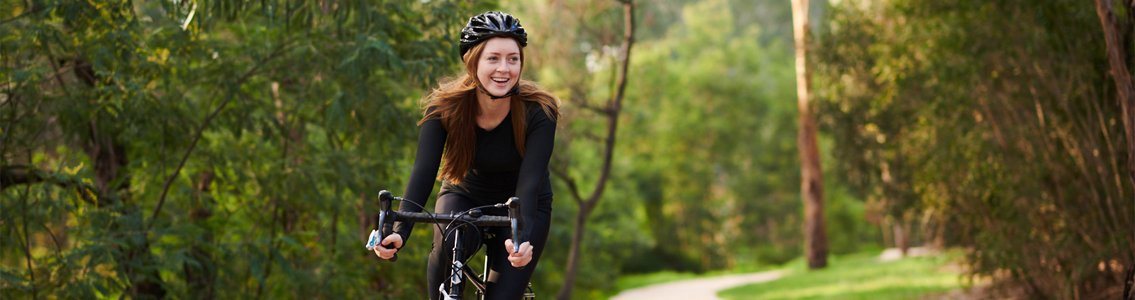 female student riding bike outside1