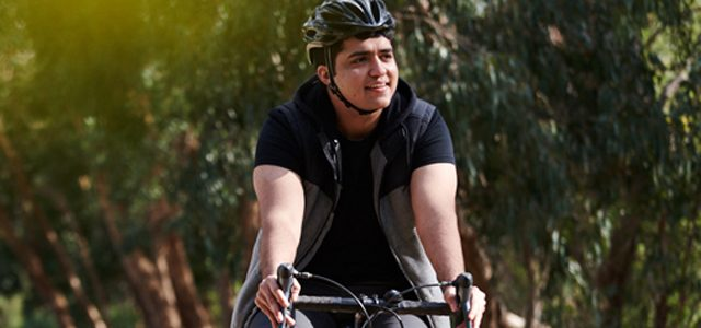 Man riding bike outdoors