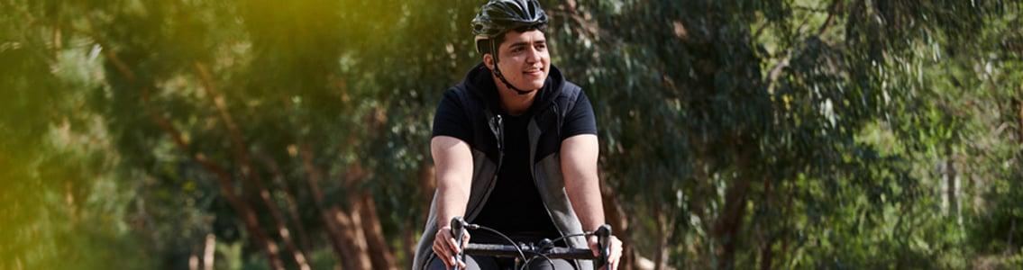 Man riding bike outdoors