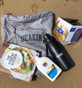 Image of contents of Summer Pack: backpack, recipe book, UE speaker, sunscreen and water bottle