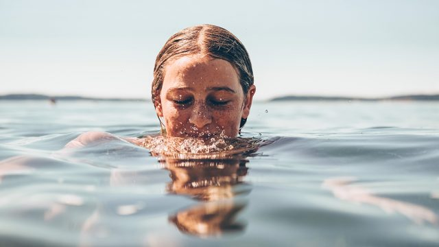 Smiling girl floating in water