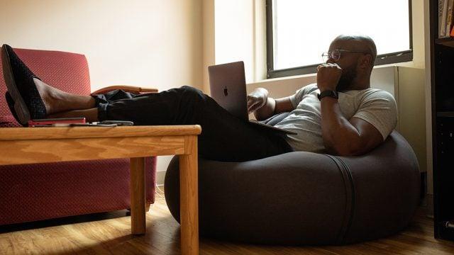 Contemplative man looking at laptop