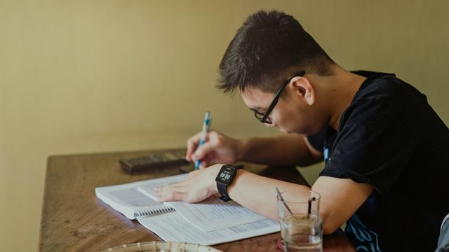 Male student revising