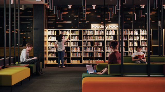 Students browsing and working in the Burwood library