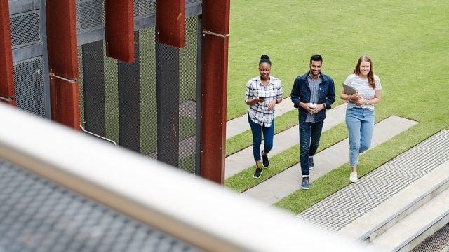 Three students walking across Waurn Ponds Campus