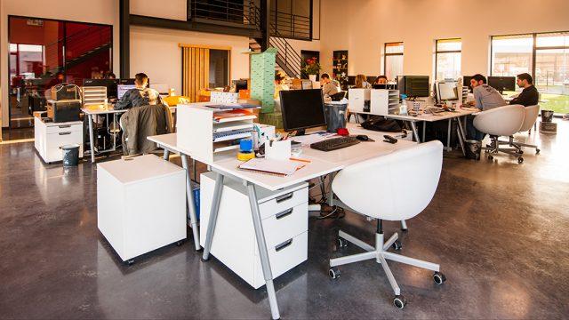 People working in an open-plan office