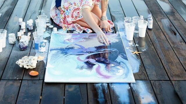 Cropped shot of female creating artwork outside