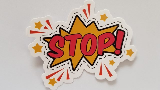 Cartoon cut-out of the word 'Stop!'