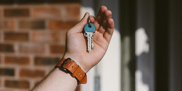 Close-up shot of hand holding house keys
