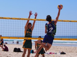 Students competing in beach volleyball