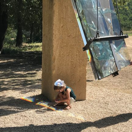 Child with outdoor sculpture