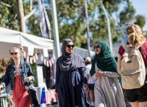 Attendees smile while walking at OWeek Burwood