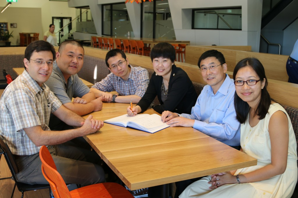 Dolly (right) with her labmates at the Institute of Frontier Materials (IFM) after a lab meeting