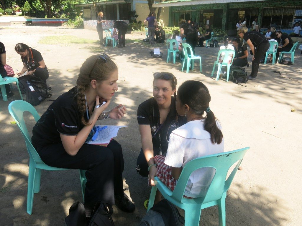 Deakin nursing students completing health checks on children in the local community