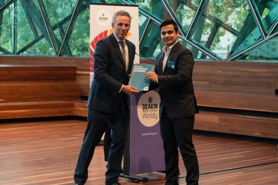 Receiving Global Citizenship Award in Melbourne