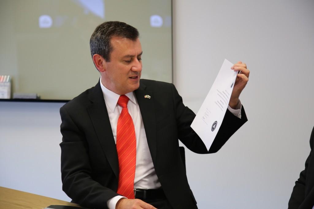Ambassador Alvarez Reina shows his Deakin University testamur