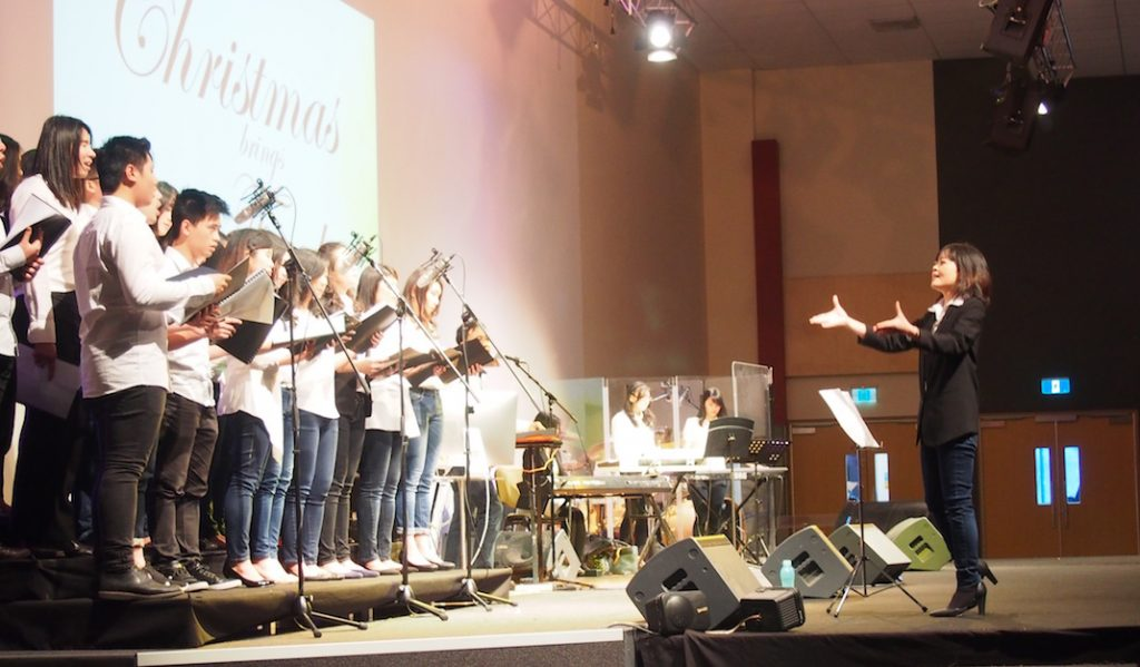 Conducting a choir for the 2015 Christmas celebration at Bethany International Church, Melbourne