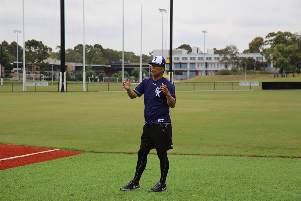 Geelong-Korea manager Dae Sung Koo gives advice to one of his players