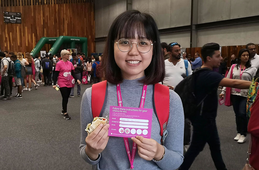 Phan enjoyed using the stamp card competition to engage with stalls at the Community Fair during the International Student Welcome.